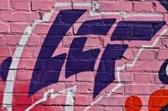 Graffiti astratti sul fondo del mattone Immagine Stock Libera da Diritti