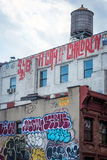 Graffiti atop Chinatown rooftops in New York City Royalty Free Stock Image