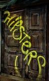 Graffiti auf alter Tür Stockfotografie