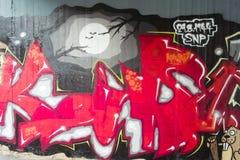 Graffiti auf der Wand. Stockbild