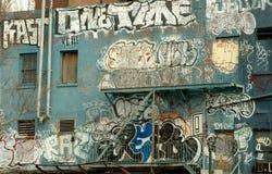 Graffiti auf einem NYC Gebäude Stockbilder