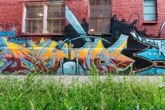 Graffiti auf Wand in der Long- Islandstadt New York Lizenzfreies Stockfoto