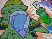 Graffiti background 08. Detail of graffiti wall with character and colors Royalty Free Stock Photos