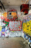 Graffiti background. Graffiti on a concrete wall at an abandoned building Stock Photos