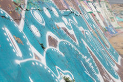 Graffiti background on street wall. In summer day Royalty Free Stock Photography