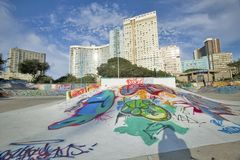 Graffiti on beach walkway with skyline of Durban skyline, South Africa on the Indian Ocean Royalty Free Stock Image