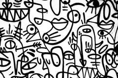 Graffiti in bianco e nero del modello sulla parete fotografie stock