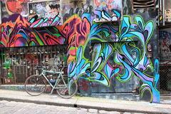 Graffiti bicycle street art Melbourne. Street art and bike in Hosier Lane Melbourne Australia royalty free stock photo