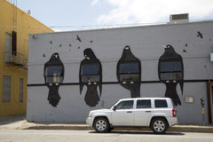 Graffiti  birds on  the grey wall of building. Graffiti birds on  the grey  wall , Deep Ellum  Dallas TX Royalty Free Stock Photos