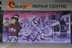 Graffiti on boardedup shop in the rundown shopping arcade St George``Walk in Croydon. St George`s Walk is a partially covered shopping parade in the centre of Royalty Free Stock Image