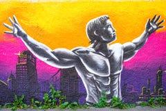 Graffiti of body builder man Stock Images