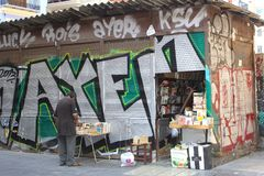 Street art graffiti and antique book store, Valencia, Spain Royalty Free Stock Images