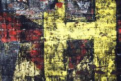 Graffiti on a brick wall. Colorful graffiti on a brick wall with a yellow letter H stock photography