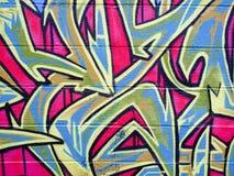 Graffiti on brick wall stock images