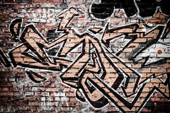 Graffiti on a brick wall. Graffiti on the brick wall of an abandoned building Stock Images