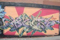 Graffiti on brick wall Stock Photography