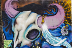 Graffiti on brick wall with cow skull Royalty Free Stock Photography