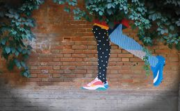 Graffiti on a brick wall in the form of legs royalty free stock photography