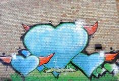 Graffiti on a brick wall Stock Images