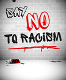 Graffiti on brick wall - SAY NO TO RACISM Stock Photos