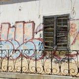 Graffiti and broken window shutters Royalty Free Stock Photos