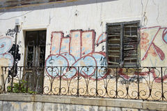 Graffiti and broken window shutters Royalty Free Stock Images
