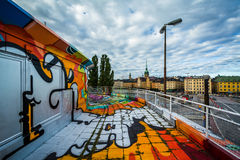 Graffiti on a building and view of Galma Stan, in Slussen, Söde Royalty Free Stock Images