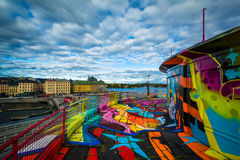 Graffiti on a building and view of Galma Stan, in Slussen, Söde Royalty Free Stock Photography