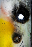 Graffiti with burned hole Royalty Free Stock Images