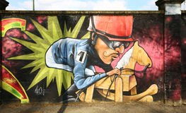 Graffiti caricature of a jockey on a wall Stock Images