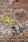 graffiti ceglana ściana Zdjęcia Stock