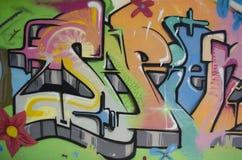 Graffiti in a children`s playground. Portugal, Algarve, Portimao.  Circa 20.10.2013. Graffiti  sprayed on the wall of a building in a children`s playground in Royalty Free Stock Photo