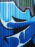 Graffiti details with blue dominant royalty free stock photos