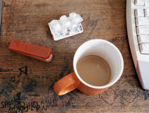 Graffiti and coffee cup on desk Stock Photo