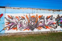 Graffiti coloré avec le portrait chaotique de modèle et de diable Image stock