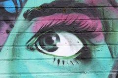 Graffiti colorati del fronte nello stile di urbano occhi Fotografia Stock Libera da Diritti