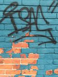 Graffiti colored brick wall stock images
