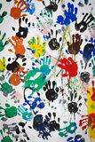 Graffiti colorful handprint on white wall. Royalty Free Stock Image