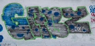 Graffiti on a concrete wall. Graffiti painted on a concrete wall Stock Photo
