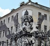 Graffiti on the corner building in Poznan In Poland. Unusual graffiti on the corner abandoned building on Old Market Square in Poznan-Poland Royalty Free Stock Images