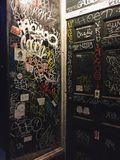 Graffiti. Covered door at night Royalty Free Stock Photo