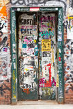 Graffiti covered doorway in New York City royalty free stock image