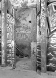 Graffiti at Bard College, New York. A black and white image of graffiti on the basement wall beside a doorway of a university residence at Bard college, New York Stock Photos