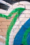 Graffiti Covers Brick Wall Royalty Free Stock Photography