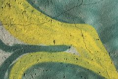 Graffiti on a cracked concrete wall. Abstract background: detail of a graffiti on a cracked concrete wall royalty free stock images