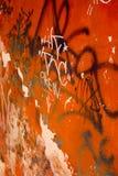 Graffiti: The Crew. Graffiti on bright orange wall Royalty Free Stock Photo