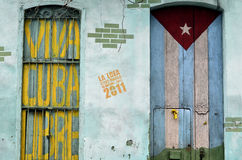 Graffiti of cuban flag and patriotic sign. Viva Cuba Libre on the old doors Stock Photos
