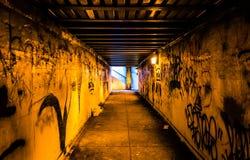 Graffiti in a dark pedestrian tunnel, in Philadelphia, Pennsylva Royalty Free Stock Images