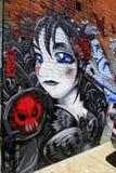 Graffiti de fille observé par bleu photographie stock libre de droits