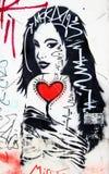Graffiti de mur de femme Photographie stock libre de droits